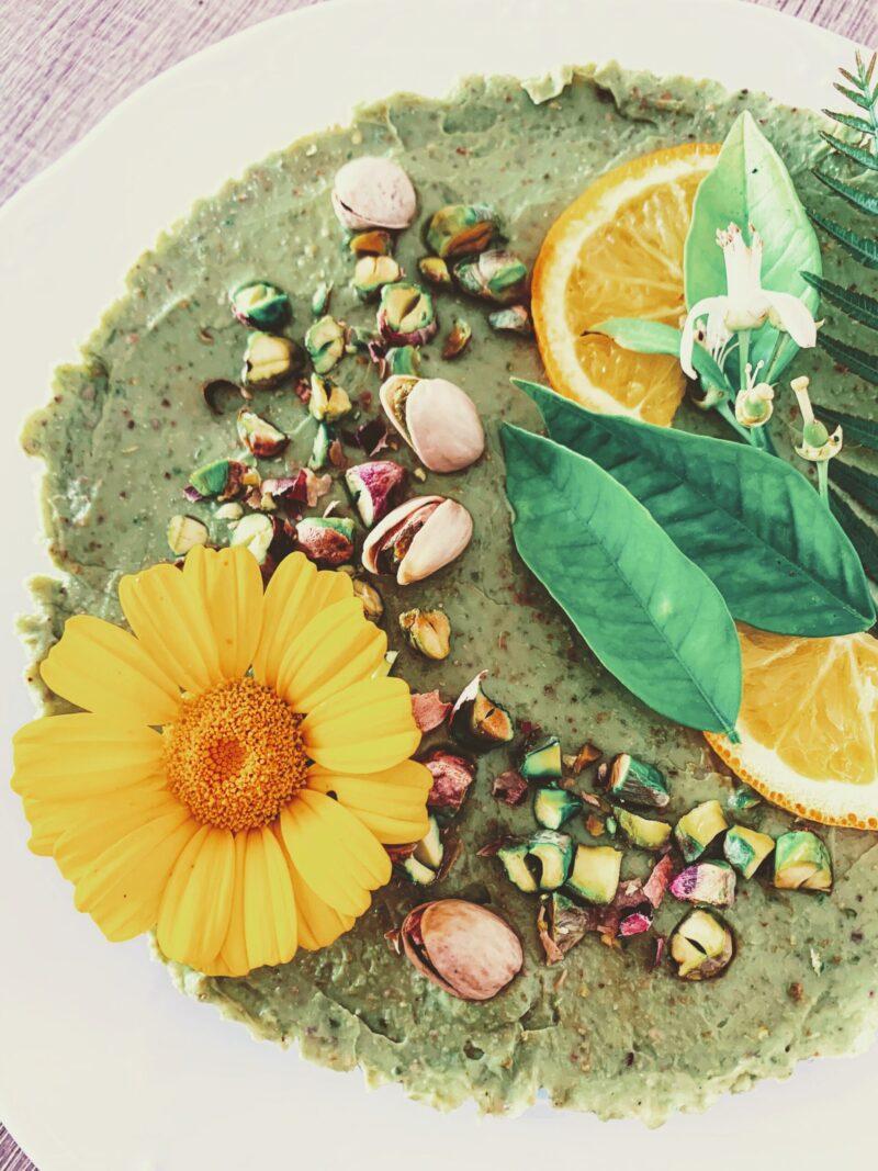 Raw pistachio cake with orange blossoms